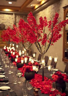 Natural and rustic with handmade red tissue paper flowers will be displayed on tables on top of red fabric table runner~
