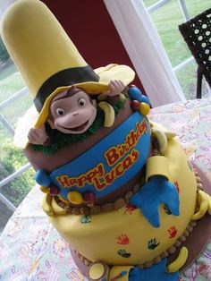 Curious George birthday cake, plus the same post also has Go, Dog, Go, Clifford, Tatty-Ratty, Goodnight Moon, Berenstain Bears, Lorax, Olivia, Giving Tree, & The Very Hungry Caterpillar cakes
