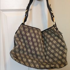 Authentic Dooney & Bourke shoulder bag Authentic Dooney & Bourke shoulder bag. Black and gray with gold hardware. Dooney & Bourke Bags Shoulder Bags