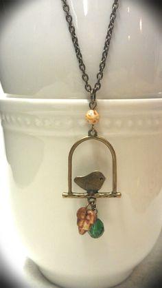 Bronze bird necklace w/ Czech and green glass beads | Two Birds Creations on Facebook