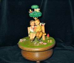 http://www.bonanza.com/listings/Anri-Music-Box-28-Note-Thorens-Swiss-Love-Story-Hand-Carved-Wood-Italy/45381093