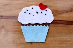 build a felt cupcake.  (but this opens up lots of possibilities: build a felt tractor, truck, house, park...)