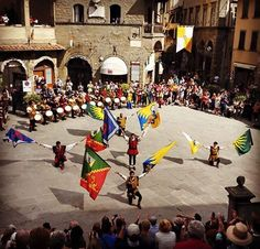 Waving flags of the different city quarter in the Medieval Celebration of the Archidado in Cortona! #archidado #cortona #jester #flags #celebration #tradition