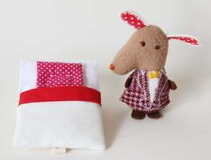 Adorable handmade soft toys that come with their own beds ready for a sleepover.  Rita Pinheiro on Etsy.