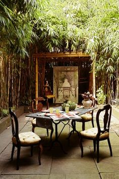 Bamboo surrounding outdoor space makes it private. Love the shrine at the back of the space.