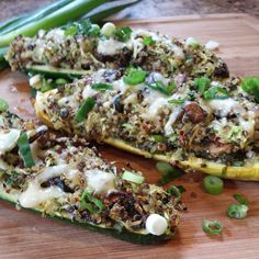 Zucchini and yellow squash boats. Quinoa, mushrooms and scallions tipped with jarlsburg cheese and…