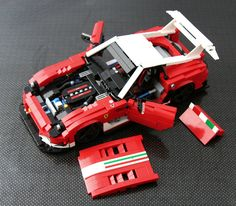 After my ageing Ferrari 575 GTC ( www.flickr.com/photos/legoexotics/5232175658/in/set-72157... ) was totaled (Sven accidentaly dropped it from it's shelf *D'Oh!*) I first considered rebulding it, as I wanted a Ferrari V-12 racer in the stables. I decided to try something more modern... since GT1 was rejected there aren't that many V-12 racers around. The FXX came to mind but there are lots of LEGO versions around (e.g. Ryan Link's) and even TLC had a try. So I went for the newest, most…