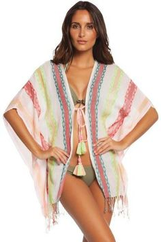 This fabulous poncho can be worn many ways and serve many purposes!  The colors are great!
