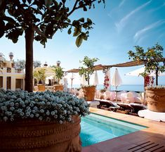 The pool deck of Le Sirenuse in Positano on Italy's Amalfi Coast where all @5staralliance guests receive 85 Euro in spa credit, a complimentary bottle of Italian Spumante upon arrival, and VIP status.