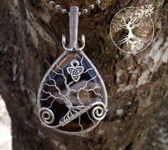 Tree of Life Pendant covering Banded Black Onyx with Triquetra Charm by TheSleepyFirefly