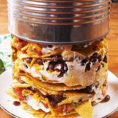 A plate of nachos is great.but a TOWER of nachos is literally next-level. Impress your game day guests by serving up this cheesy, spicy, full-of-flavor, app, made for sharing. It's inspired by Guy F Trash Can Nachos Recipe, Mexican Dishes, Mexican Food Recipes, Nacho Recipes, Hot Dog Recipes, Broccoli Recipes, Barbecue Recipes, Football Food, Appetizer Recipes