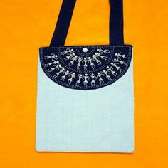 The appealing Warli tribe embroidery of this bag catches attention at a single glance tempting to desire one. $9