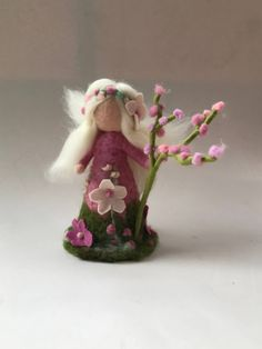 Spring Fairy needle felted. Waldorf education standing doll. Arms are flexible. Size ,Spring Fairy 8 inches high. Your purchase will be sent within 5/10 business days. If you need something to be shipped faster, please contact us. We ship from Germany to keep the shipping cost as low as