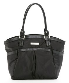 """Every on-trend mama deserves to tote changing essentials in style and this haute diaper bag performs the task with fashion to spare.A plethora of slip pockets provide perfect places for organizing necessities, while an adjustable shoulder strap and dual handles allow the bag to be carried in a variety of ways.Includes bag, bottle warmer, changing pad and pouch17"""" W x 13"""" H x 5.5"""" D9"""" shoulder dropCoated nylon / leatherImported"""
