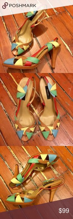 "DKNY Rainbow Strappy Sandals DKNY Leather Sandals. Red, yellow, blue, green, and tan leather. 4"" heel height, 10.25"" toe to heel. Minor wear and tear throughout, as pictured. Otherwise in excellent condition!   On here to declutter, 🚫 trades. If I want something in your closet badly enough, I'll buy it 😍 Reasonable offers always welcome! Dkny Shoes Sandals"