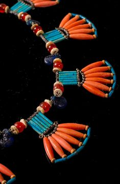Antique Egyptian Coral and Hardstone Fan Necklace. The necklace was created from various beads discovered in different regions of Egypt that date from 1850 B.C..