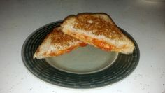 Grilled Cheese Pizza - Provolone, parmesan and pizza sauce inside, multi-grain bread toasted in a pan with garlic infused olive oil.