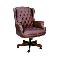 Wingback button-tufted office chair with a hand-applied nailhead trim. Product: Office chairConstruction Material: