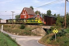 "Southbound Central Vermont freight with ""new image"" painted GP-9 4559 in the lead, passes through Westminster,Vt.    Photographed by David S.Hutchinson, September 29, 1987."