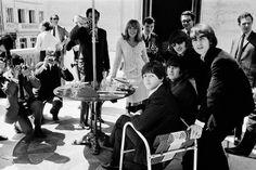 The Beatles at their Paris hotel on June 20, 1965 in Paris.