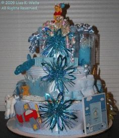 The first diaper cake I ever made, for a good friend.  Three tiers, and lots of goodies.  See http://www.lisasgiftcakes.com for more options or to order!