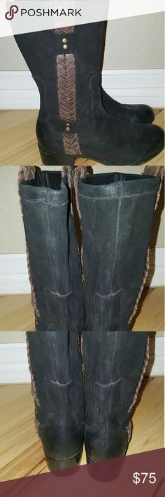 Ugg boots Gorgeous leather Ugg boots with a pretty brown leather braid that goes top to bottom making a great accent.  These boots are in amazing condition with no flaws to note UGG Shoes Ankle Boots & Booties