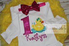 This rubber duck first birthday outfit is perfect for those smash cake photos! It comes complete with free monogramming, skirt and headband! #monogram #monogrammed #firstbirthday #rubberduck #applique #appliqued #pettiskirt #tutu #headband #glitter #smaskcake