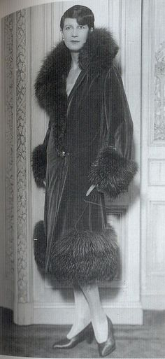 """Monkey fur trims on jackets and fox stoles, complete with head and tail were popular for formal occasions and used to soften the edges of clothing. This theatre coat of 1925 by the House of Redfern is trimmed with wolf fur.""    Scanned from the book ""Decades of Fashion""."