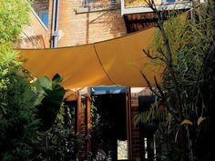 When temperatures rise, awnings are an essential weapon in the cooling arsenal–blocking direct sun and creating zones of shade. The best development we've