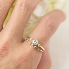 Genuine three diamond ring is called Star and Moon Ring, made in solid 14k gold, and can be made in platinum. Inspired by vintage art deco style ring is perfect for everyday wear as the diamond gives just the right amount of sparkles to your finger. The ring has a main diamond about 4mm