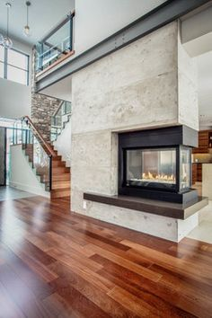 Robyn- nice palette for FP, steel beam Sublime Fire Place decorating ideas for Glamorous Family Room Contemporary design ideas with 3 sided fireplace 3 sided glass fireplace cantilevered landing concrete finish concrete 3 Sided Fireplace, Fireplace Frame, Cabin Fireplace, Concrete Fireplace, Faux Fireplace, Living Room With Fireplace, Fireplace Surrounds, Fireplace Ideas, Fireplace Cover