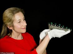 A Historic Royal Palaces conservator preparing Queen Victoria´s diamond and emerald diadem...