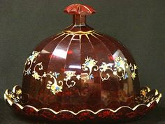 Antique Moser Bohemian art glass cheese dome. Intense ruby red glass, decorated with a delicately hand painted floral motif, accented with plenty of raised gilt enamel.