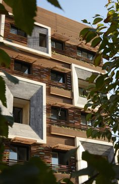 This project, designed by Iranian studio Keivani Architects, was heavily influenced by Iranian traditional architecture. They used a special type of window called Orsi, made of wooden lattice and stained glass which was very effective when it came to Iran Architecture, Minimalist Architecture, Architecture Wallpaper, Futuristic Architecture, Architecture Details, Futuristic Design, Building Elevation, Building Facade, Building Design