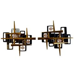 Pair of Sconces Signed by Leon Calderi | From a unique collection of antique and modern wall lights and sconces at http://www.1stdibs.com/furniture/lighting/sconces-wall-lights/