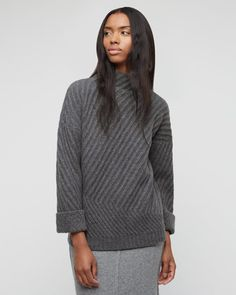 Signature funnel-neck jumper crafted in soft wool with a brush of cashmere for a beautiful, soft finish. Deep diagonal rib detail, turn-up cuffs and relaxed fit from neck to hem. Add this contemporary piece to your casual wardrobe this season.