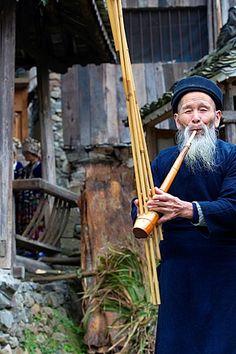 China, Guizhou province, Langde village, Miao minority man playing lusheng.