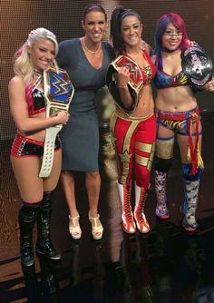 Stephanie McMahon with SD Women's Champion Alexa Bliss, Raw Women's Champion Bayley & NXT Women's Champion Auska