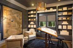 I love love love the map...of course.  But I love the small space with dark paint and built ins with contrasting white trim...awesome