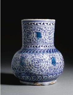 A rare Iznik blue and white 'Golden Horn' jug, Turkey, circa 1530-40