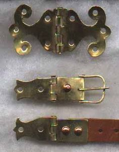 Top, type A lobed hinge; below, buckle and strap fittings with fancier hinge bases. Most strap and buckle hinges were simply rectangular, though some had concentric circles stamped around the rivet holes