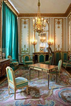 La Cabinet doré de Marie-Antoinette. Petit appartement de la Reine, Versailles, France. Note the Neoclassical 'Grottesco Candelieri' on Bass Relief on the wall and the slender classical  lines of the delicate Luis XVI Style Furniture.