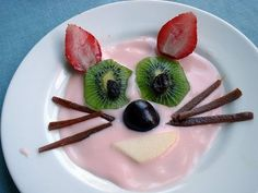Fruity Kitty. She is made out of yogurt, kiwi, strawberries, raisins, apple, cherries and fruit leather (for the whiskers).