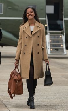 Malia Obama is taking style tips from mom Michelle Obama. As in: an elegant camel coat. | MARIE CLAIRE