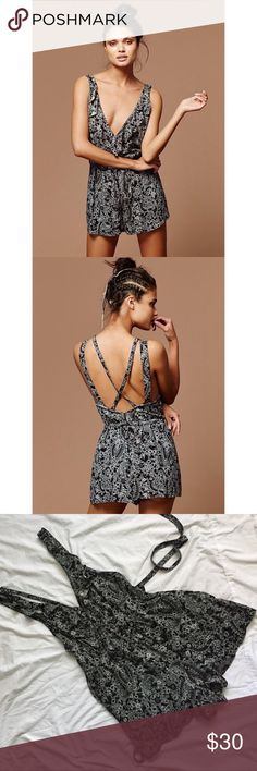 Free People Defonic Romper This adorable romper has been worn once, and is in good condition. Sultry romper featuring a ruffled surplice plunging neckline and open strapping back. Very comfortable and perfect for the summer. Sold out online and in stores Free People Pants Jumpsuits & Rompers