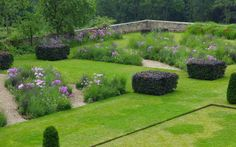 Garden design: pink and purple shades in Derbyshire Clipped copper beach hedges are wonderful