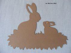"""Sie kaufen hier ein selbstgebasteltes Fensterbild  aus Tonkarton. """"2 Hasen im Gras """"   Größe ca. 26 cm x 20 cm Farbe: Hell-Braun   Versand- und Verpackungskosten: Deutsche Post Brief 2,20..."""