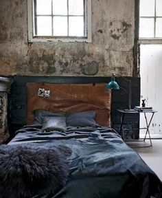 <3 this industrial style bedroom.. especially <3 the leather headboard