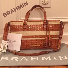 "BRAHMIN ASHER WHISKEY RAFFIA/LEATHER SATCHEL CLASSY and MINT condition!!!  Brahmin Wonderful quality can't be beat. Raffia and Whiskey color crocodile embossed leather. As always, adjustable shoulder straps, brass hardware and protection feet in bottom. This style also has the hanging tassels!!!  Interior has the Brahmin signature fabric with zip pocket, 2 slip pockets, 2 pen slots and key clip. Comes with dust bag, authenticity card and price tag. 14""x8""x5"". Brahmin Bags Satchels"