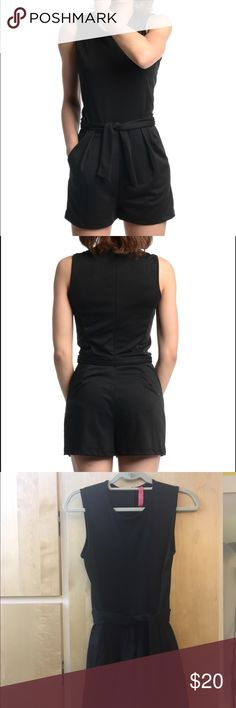 Eight Sixty Black Romper Black romper with pockets, zipper in the back and tie in the front. Tags have been removed but has never been worn, in great condition!! Eight Sixty Pants Jumpsuits & Rompers